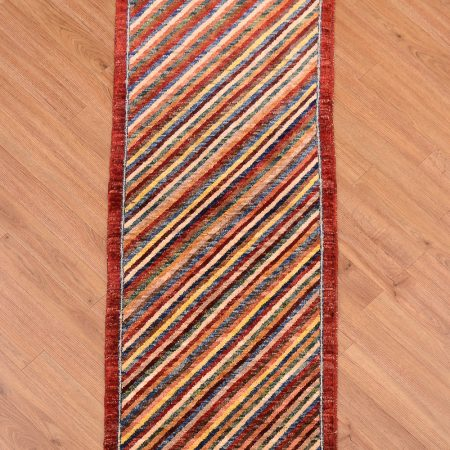 Handmade Afghan Chubi Strip with modern design of narrow diagonal stripes surrounded by a narrow red border.