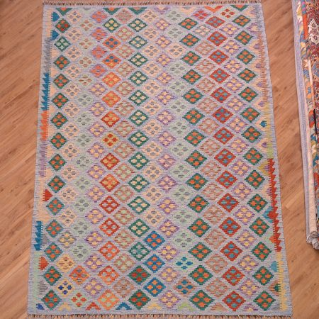 Jazzy hand-woven Afghan Maimana Kilim with all over design on a two tone light blue background.