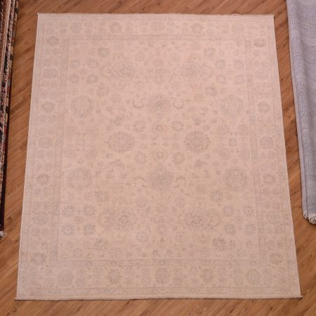 Light colour hand-knotted Afghan Beige Ziegler Carpet with all over, faint floral pattern.