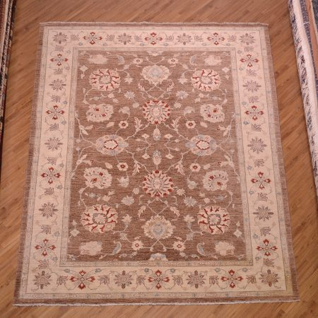 Great value handmade Afghan Brown Ziegler Carpet with beige border and touches of red and blue.