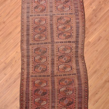 Splendidly wonky & wonderfully faded antique Ersari Wide Runner with gul design separated into panels.